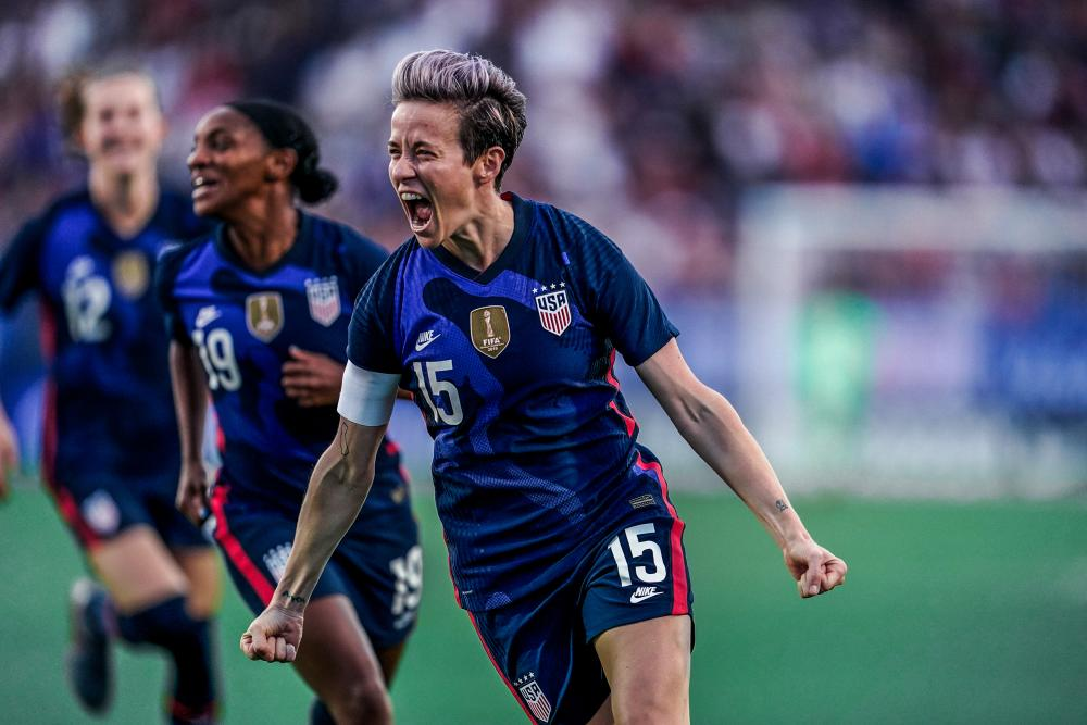 Meagan Rapinoe cheers after scoring for the US Womens National soccer team