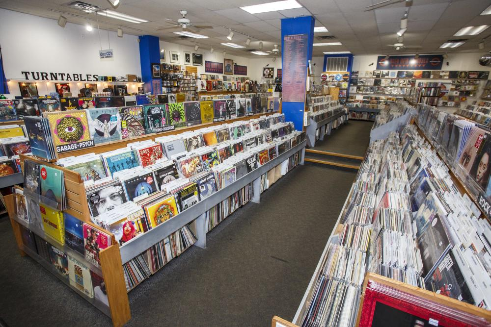 Store interior with rows of vinyl and CDs at Waterloo Records in Austin Texas