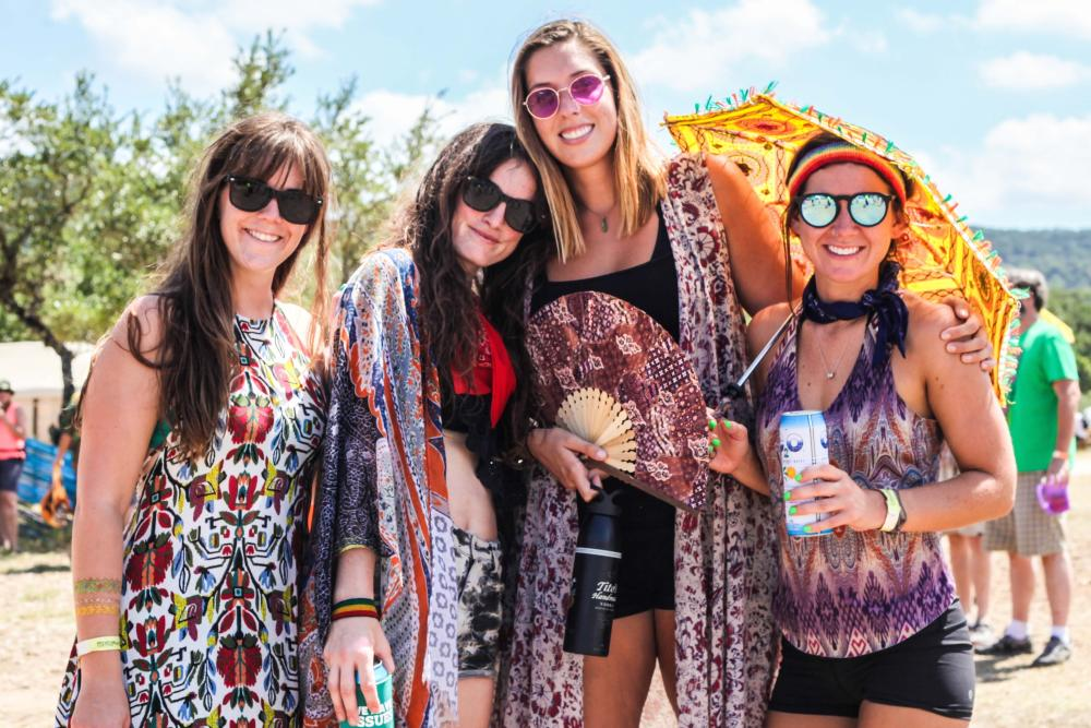Four women smile at camera during Utopiafest down in the Oaks near Austin Texas
