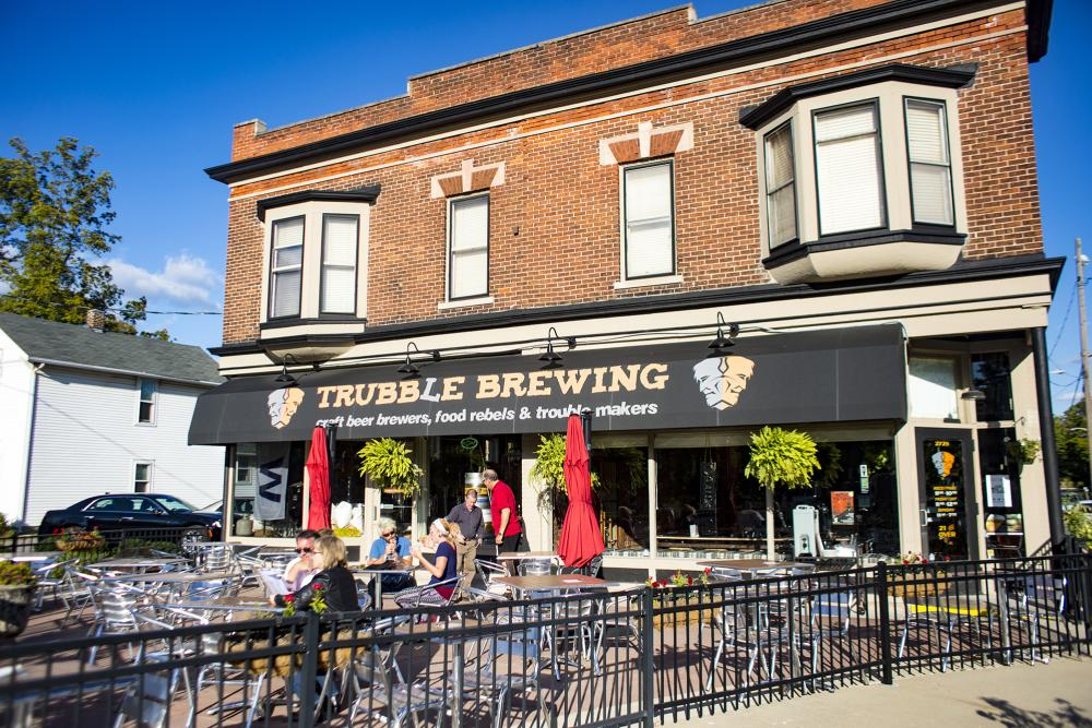 People dining on the outdoor patio at Trubble Brewing in Fort Wayne