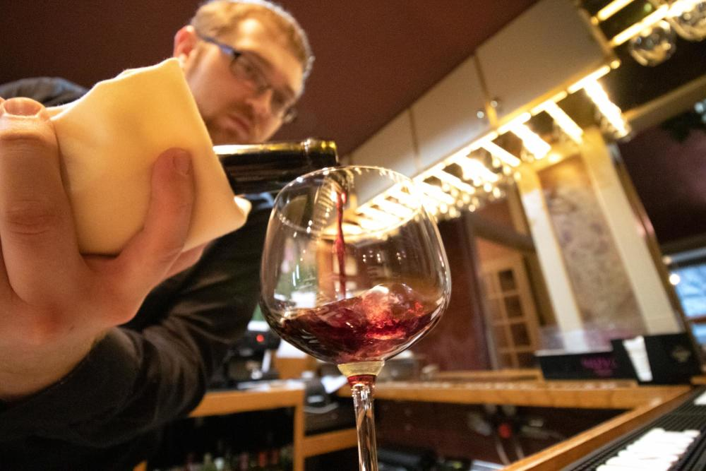Pouring Wine at Cafe Bel Ami