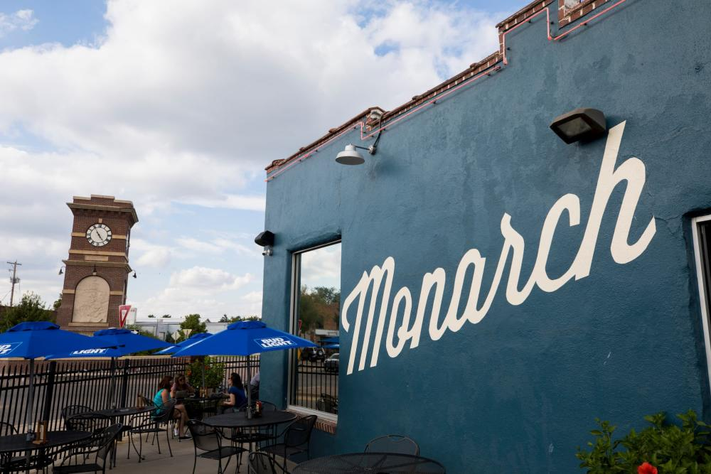 Photo of the Monarch's patio and side of building with the Delano clock tower in the background