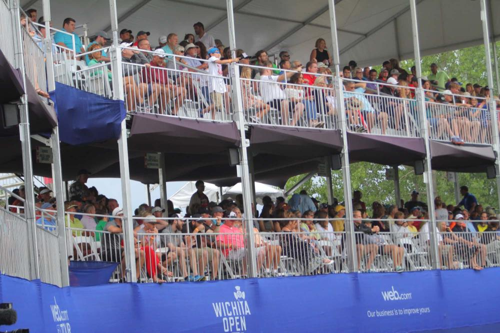 Two levels of seating are full of spectators on the 17th hole at the Wichita Open