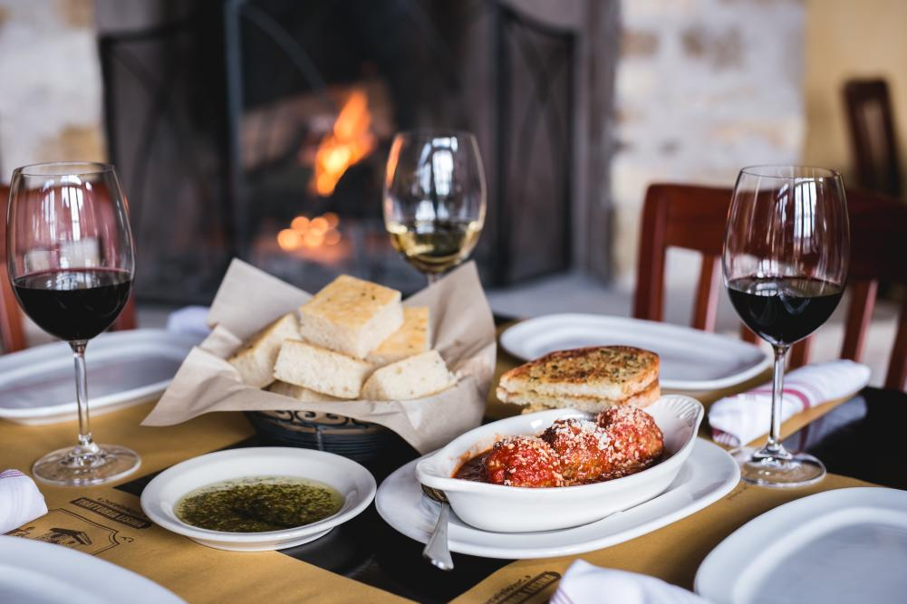 Appetizer with bread and wine at Trattoria Lisina in Driftwood TX