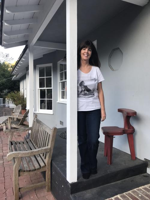 Lynell Seabold standing on Ava Gardner's former porch in Nichols Canyon.