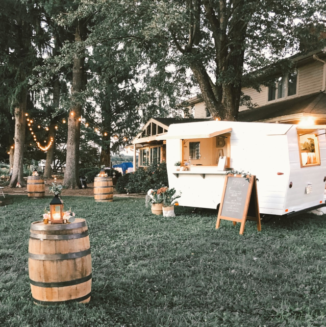 A backyard is party ready with a Vintage Views mobile bar set-up