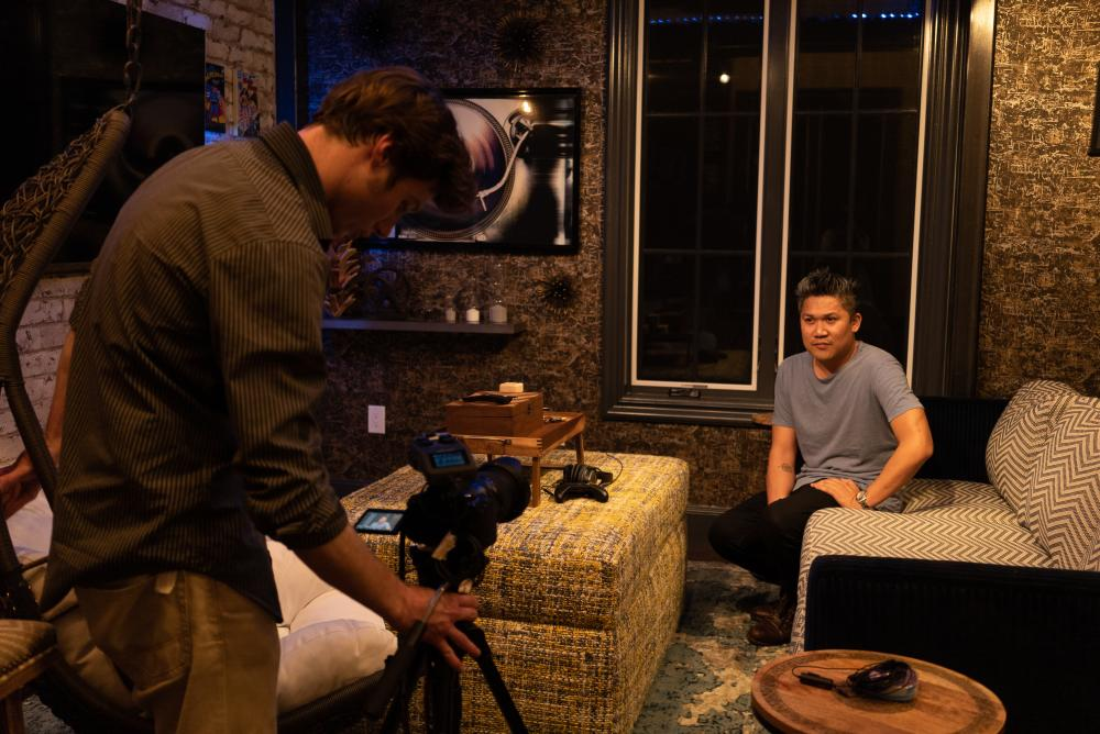 Filmmaker with camera shooting movie with Austin Asian American Film Festival