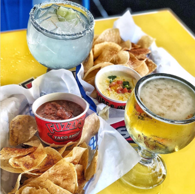 Chips with salsa, queso, and margaritas at Fuzzy's Tacos in Irving, TX
