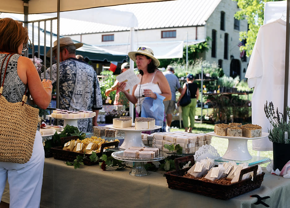 Women talking at booth during Blanco Lavender Festival