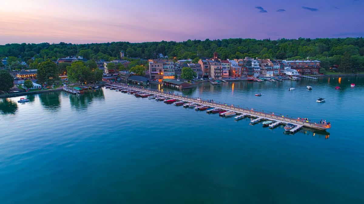 Overhead photo of town of Skaneateles, Skaneateles Lake and the Pier at dusk