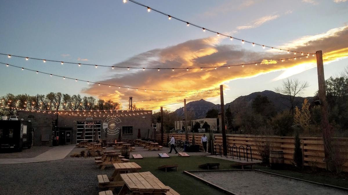 Outdoor seating and games at Rayback Collective Food Truck Park Boulder