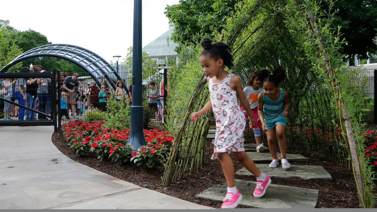Kids play in the Children's Garden at the Franklin Park Conservatory & Botanical Gardens in Columbus.