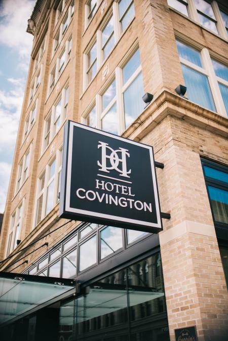 outdoor brick and windows with sign for Hotel Covington on Madison Avenue in covington ky