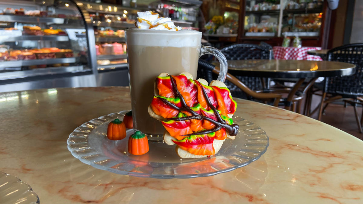 Rao's pumpkin spice latte with a sugar cookie decorated as a fall leaf