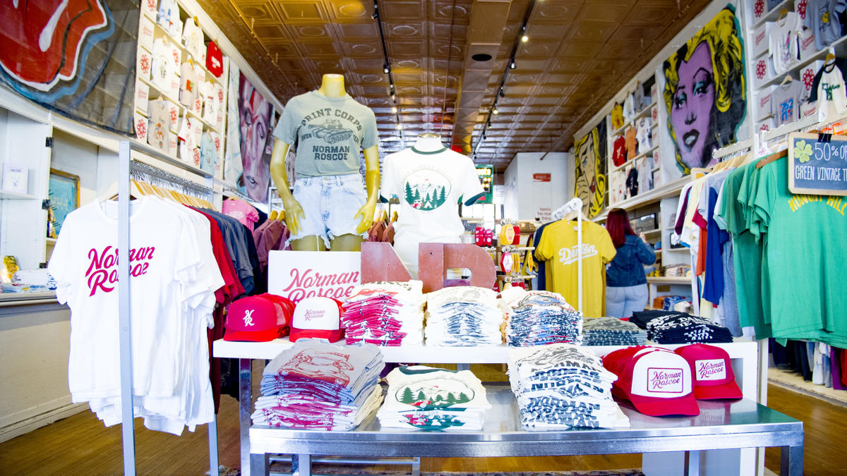 A shop display of t-shirts and hats in Norman Roscoe