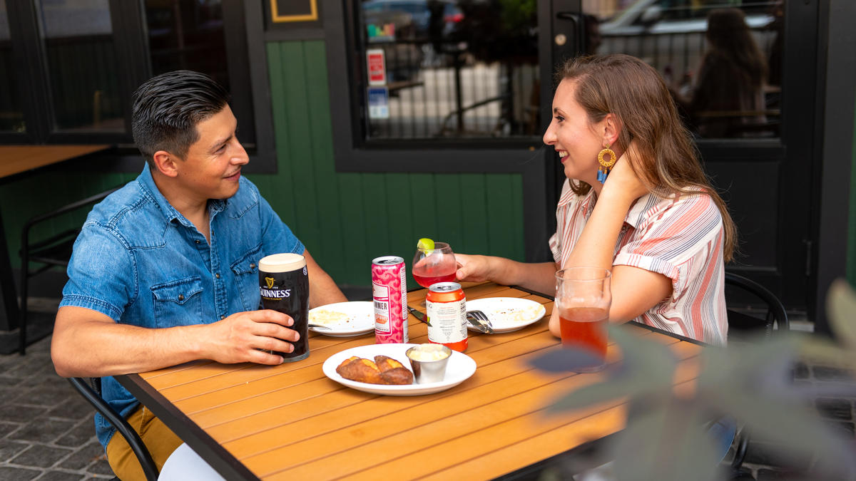 couple eating outside at JK O'Donnell's Irish Pub in Fort Wayne
