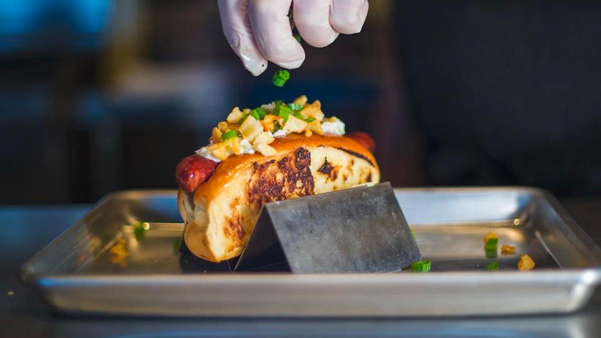 Close up of a gourmet hotdog.