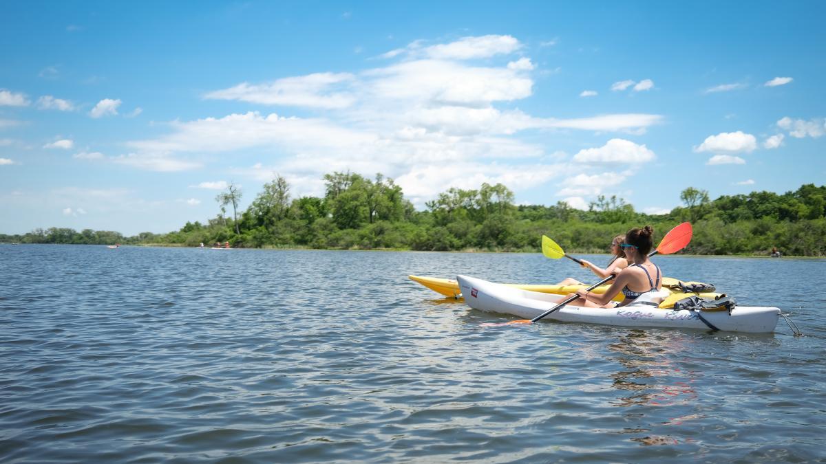 Two women kayaking on Lake Wingra Madison, WI