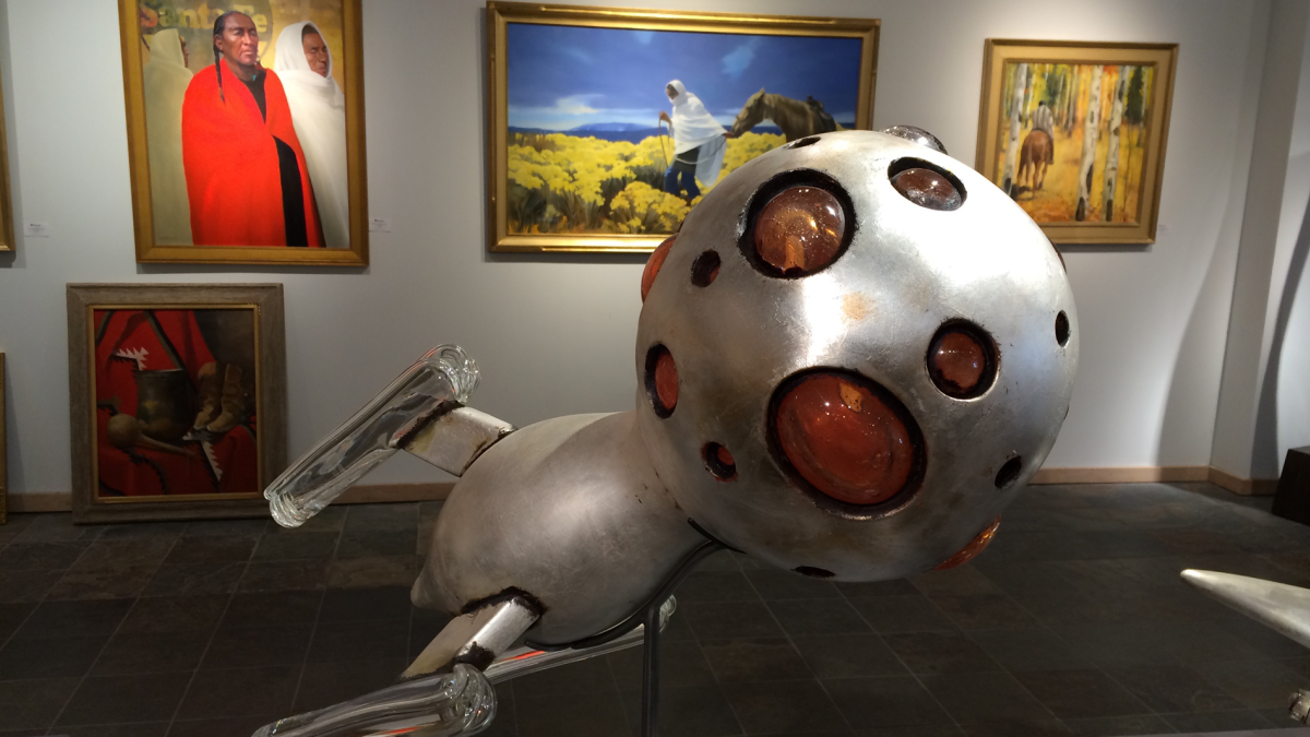 Contemporary sculpture mingles with Southwestern-inspired paintings at a New Mexico art gallery.