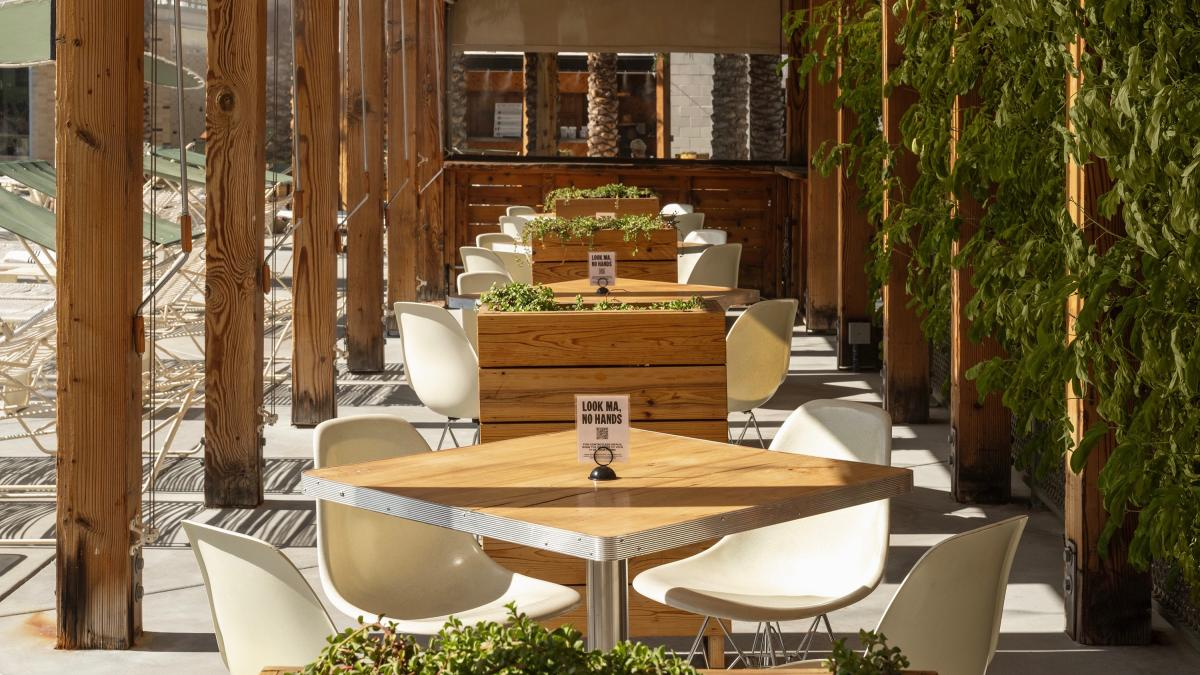 Outdoor dining patio at Ace Hotel & Swim Club
