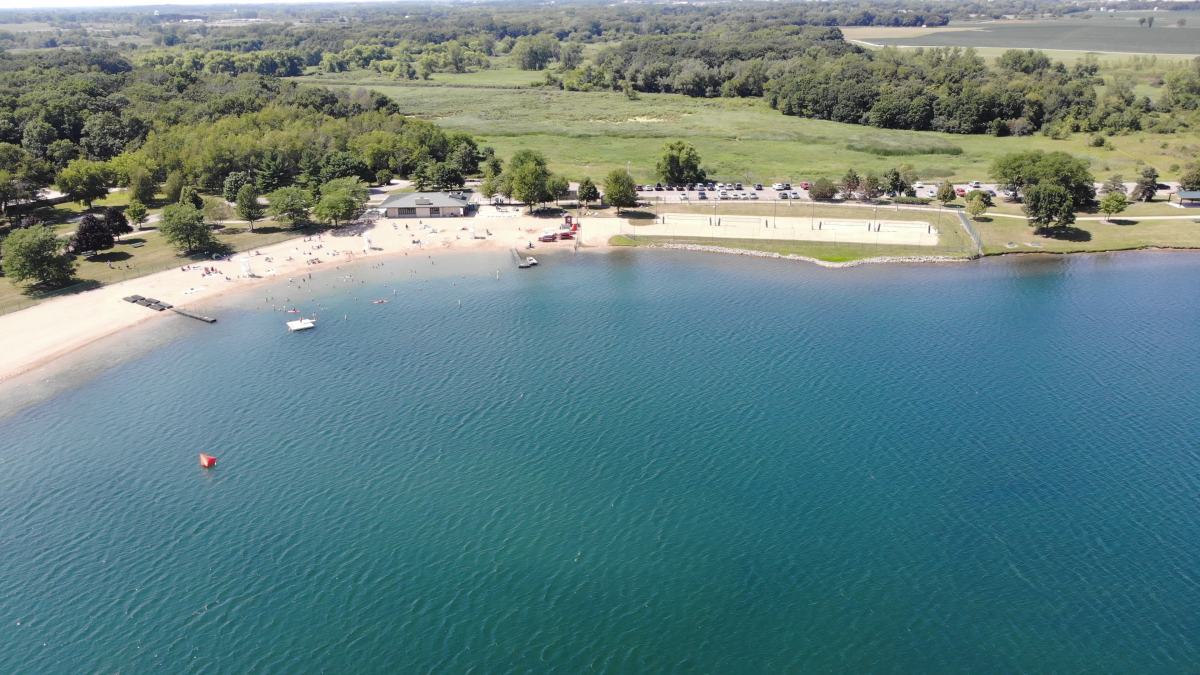 Aerial View of Lake Andrea with People on Beach