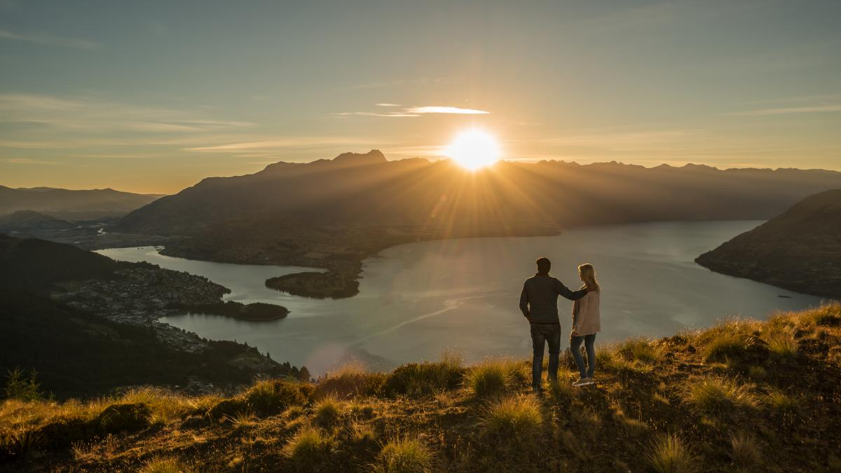 Couple viewing sunrise from Remarkables view point