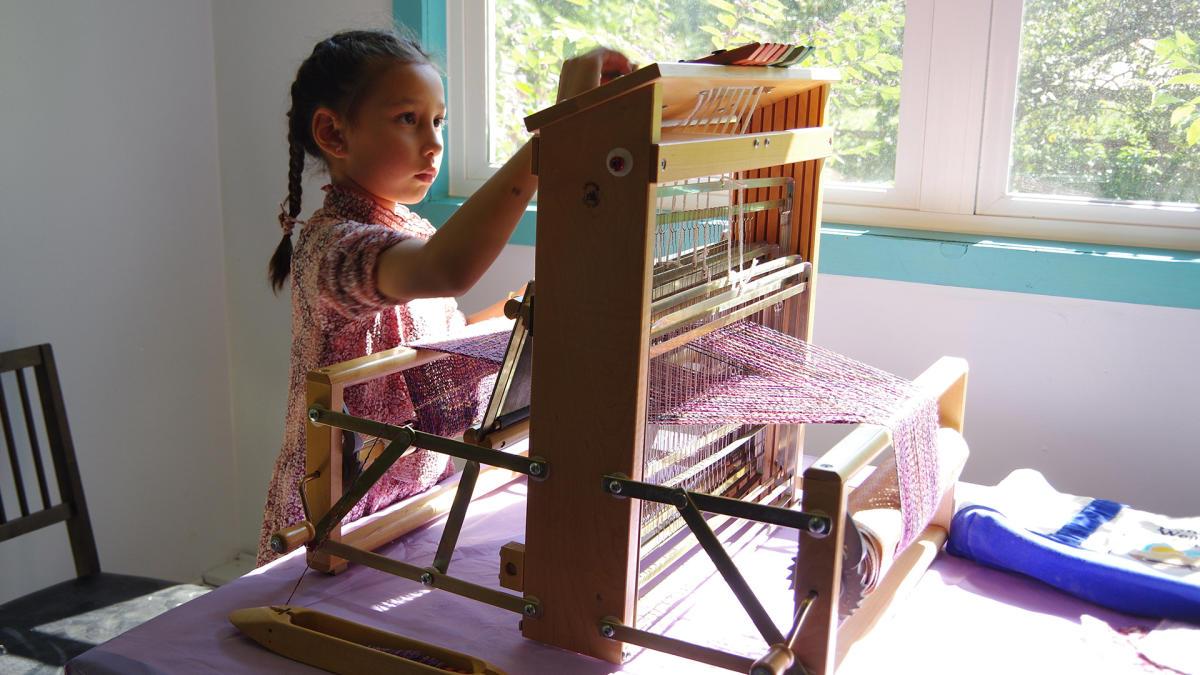 Art Barn - child weaving at Art Blitz