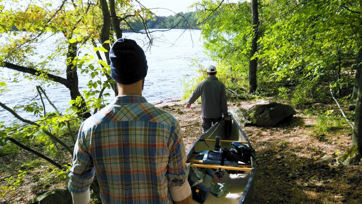 Timothy Bauer, writer for Miles Paddled, prepares to launch a canoe trip with a friend.