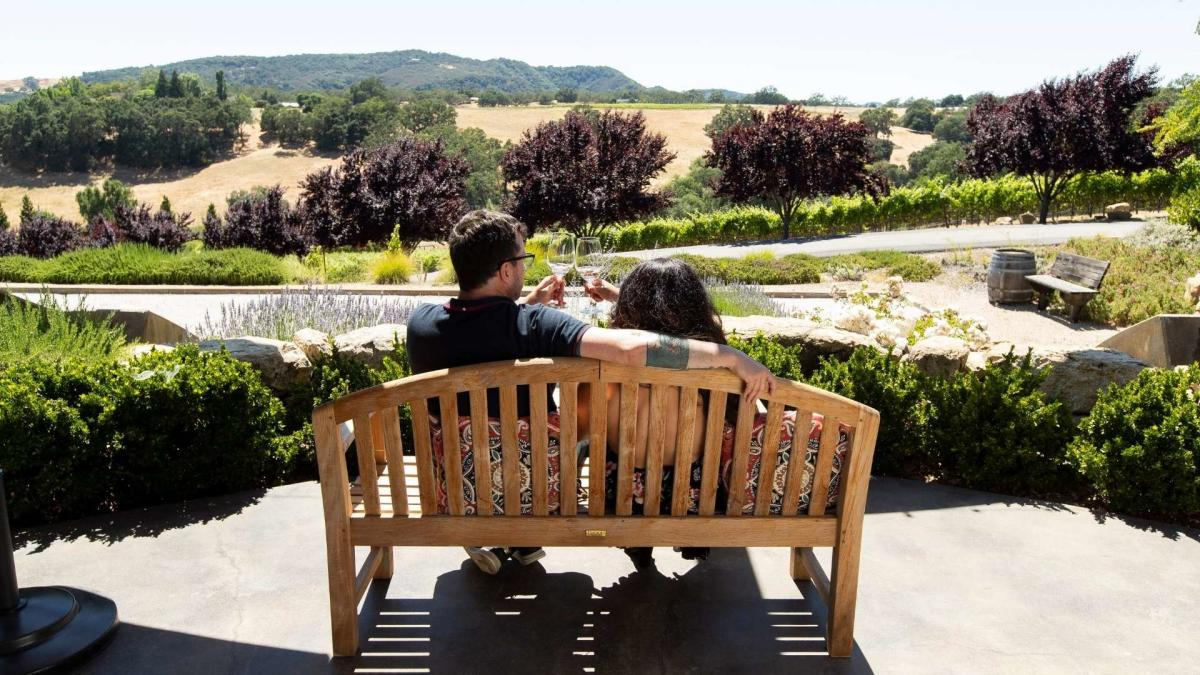 Enjoying wine on a bench in Paso Robles, CA