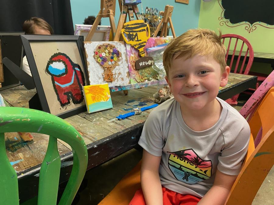 boy in a studio with painted items