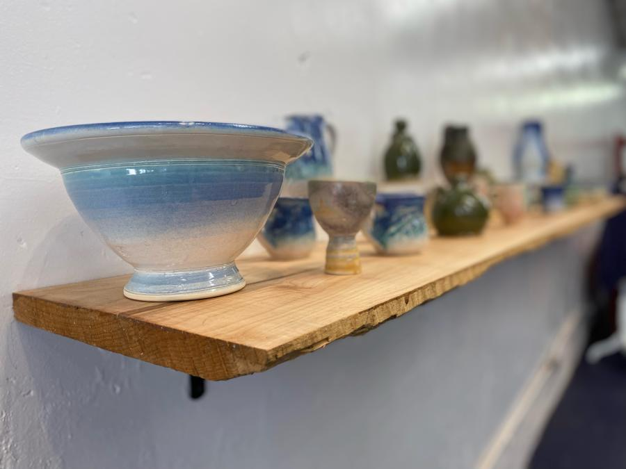 glazed pottery items on a shelf