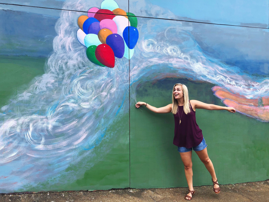 Balloon and wind mural with girl holding balloon strings