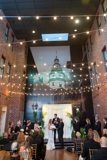 A couple gets married at the Governor Calvert House.