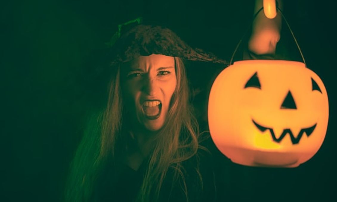 Spooky witch with jack-o-lantern