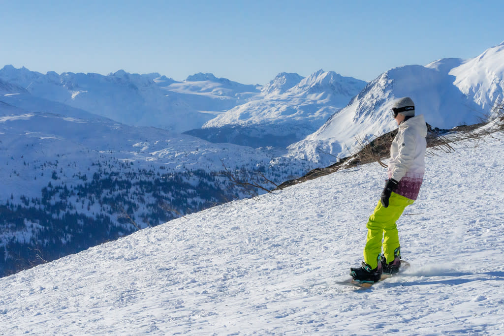 A person snowboarding in a mountain pass