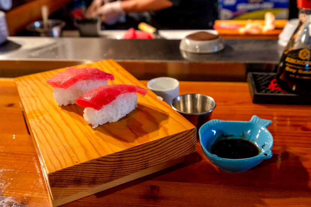 Nigiri on a wooden plate on a table