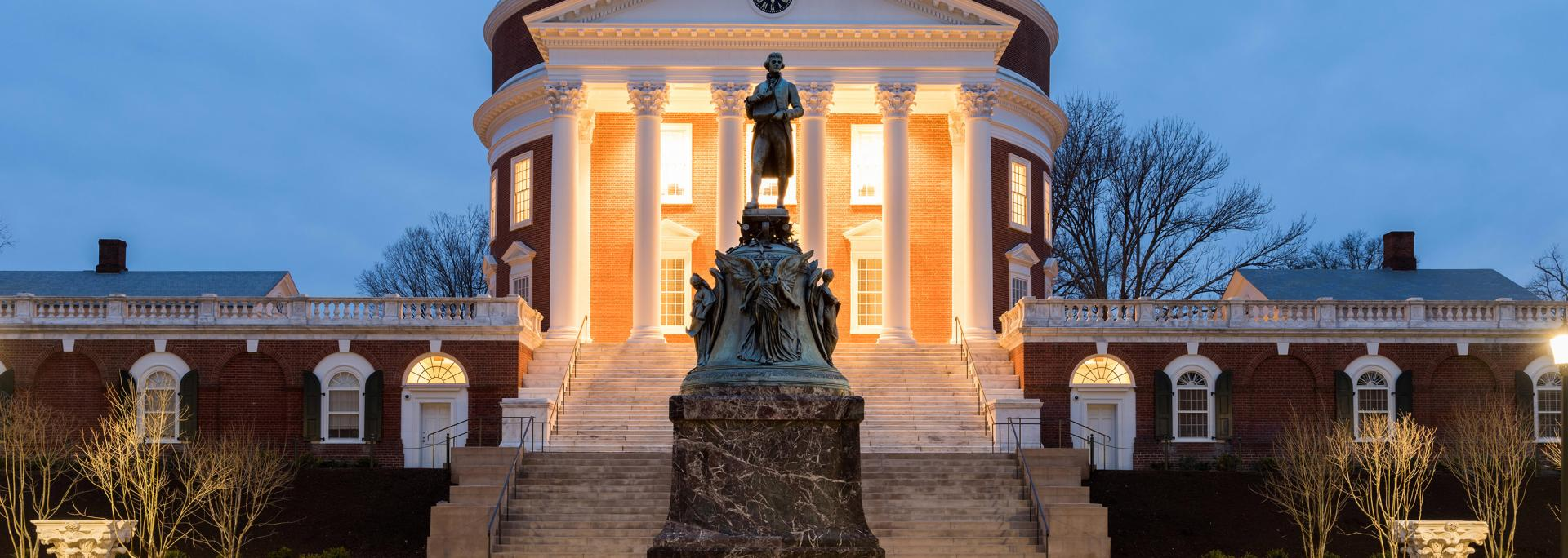Evening photo of UVA Rotunda and Jefferson statue