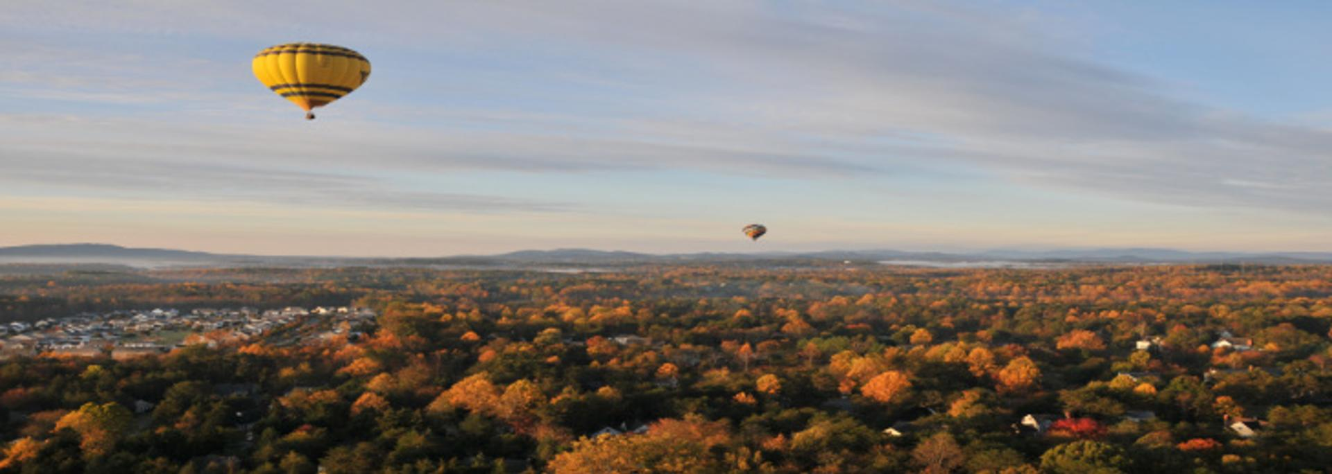 Hot air balloons floating over Charlottesville in the fall