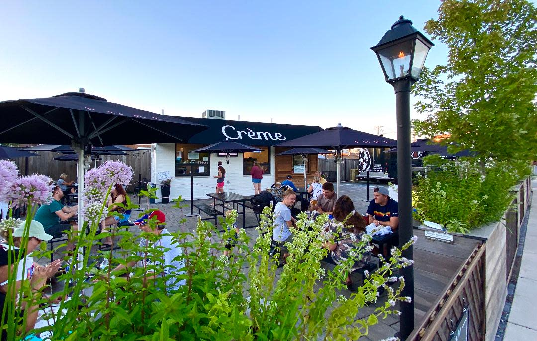 Outdoor patio with picnic tables at Fuel & Creme