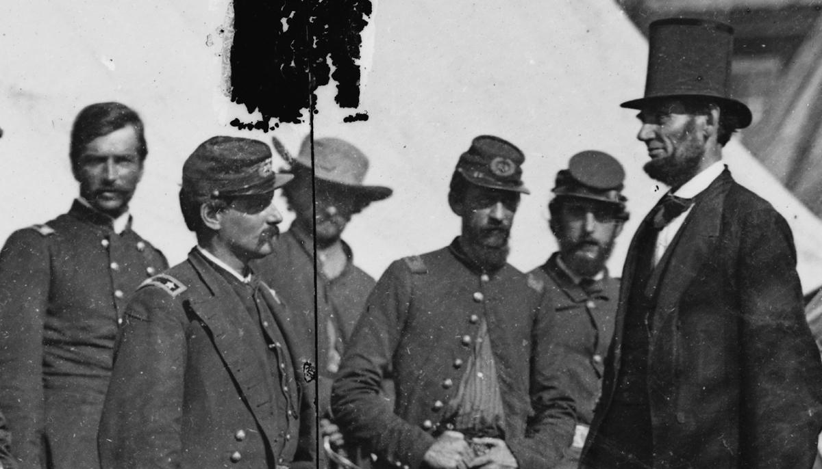 Abraham Lincoln standing with a group of soldiers at the Battle of Antietam