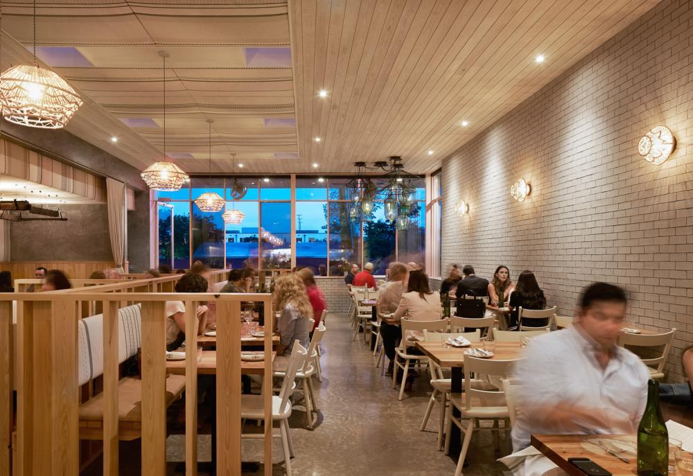 Suerte restaurant interior with people dining in Austin Texas