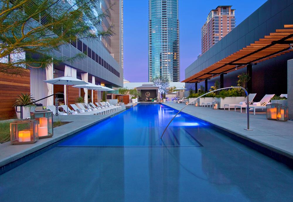The pool at W Austin hotel at twilight In Austin, TX