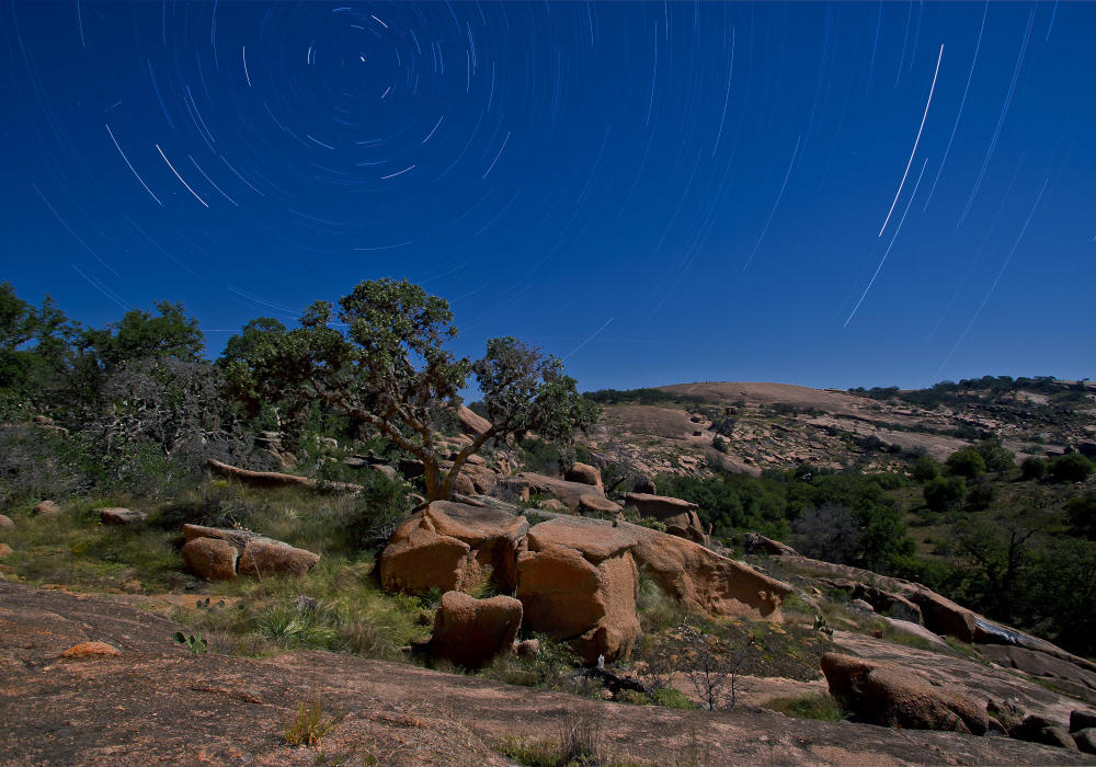 Enchanted Rock State Natural Area at night with stars In Austin, TX