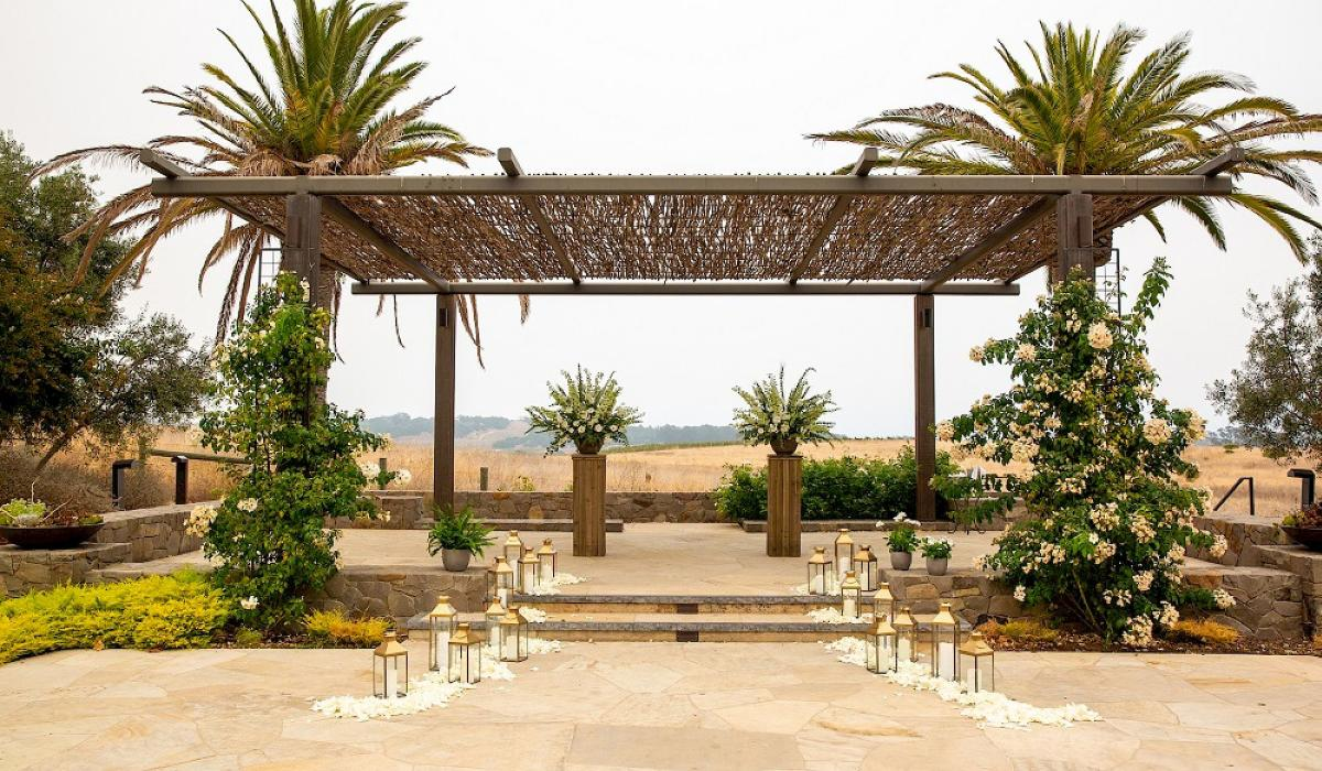 Alter with palm trees on either side Carneros Resort Wedding