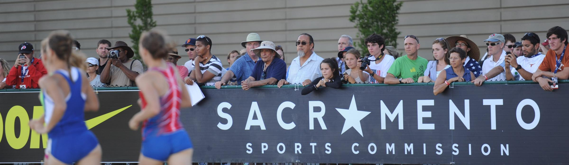 Sacramento Sports Commission sign at a track meet