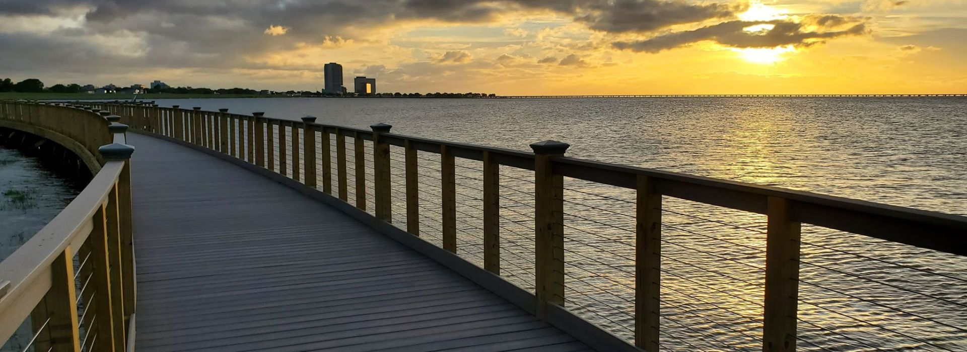 A sunset view from the Bucktown Marsh Boardwalk on Lake Pontchartrain