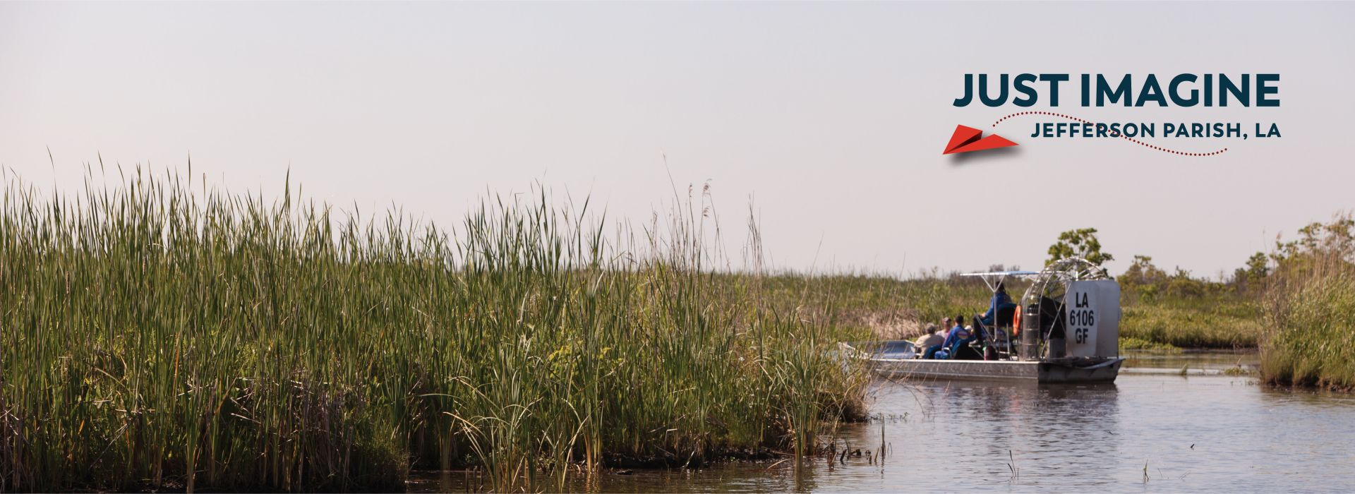 "People on an airboat during a swamp tour with the ""Just Imagine"" logo"