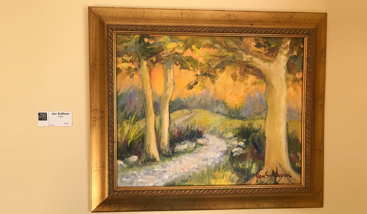Jan Sullivan painting at Art Barn