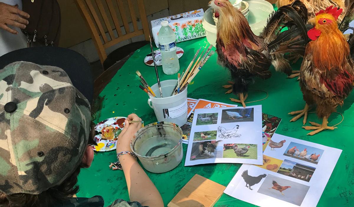Chicken painting table at Art Barn's Art Blitz 2021
