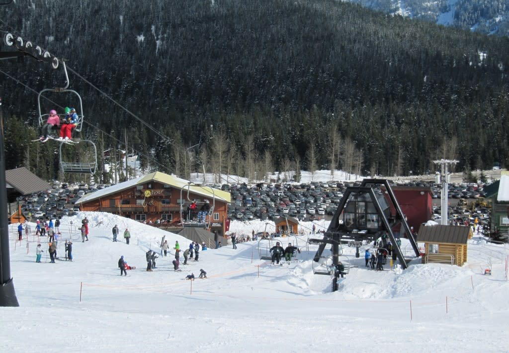 Snow, Skiers, and chair lift at Summit at Snoqualmie
